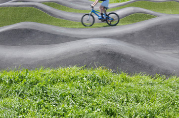 Man riding bicycles on pump track