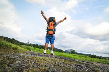 Male backpack happy with journey and nature view.