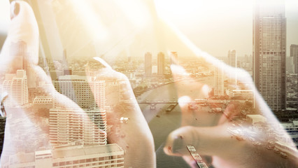 digital tablet double exposure and and cityscape background. Business technology concept.