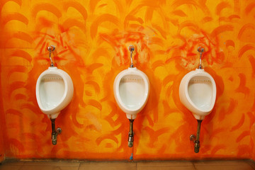 Vintage restroom interior photo with urinal row
