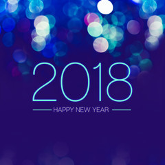 Happy new year 2018 with blue bokeh light sparkling on dark blue purple background,Holiday greeting card