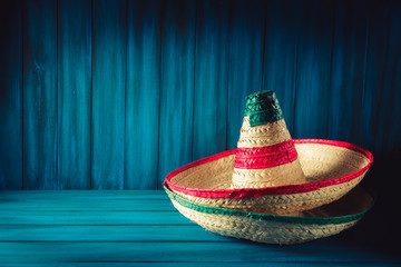 High contrast image of mexican hats on a wooden background