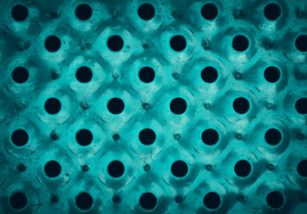 Perforated green iron background texture surface