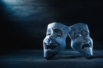 Theater masks on a dark background / 3D Rendering