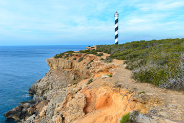 In de dag Vuurtoren Moscarter lighthouse at the north coast of Ibiza island, Spain