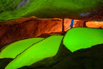 Colorful pools of Can Marca Cave, Ibiza, Spain