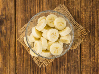 Portion of Sliced Bananas on wooden background, selective focus