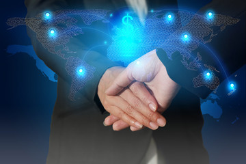 Double exposure of businessman handshake, light blue dollar sign bulb and line node networking world map as business, commitment, globalization and innovation concept.