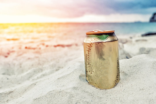 A can of beer on the beach