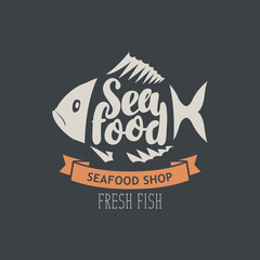 Vector emblem or banner for seafood shop with decorative fish, inscription seafood and words fresh fish on the dark background in retro style.