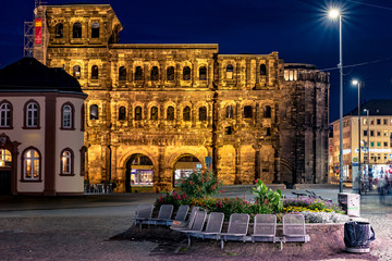 The Porta Nigra, Latin - black gate, view from south, Trier, Germany. Ancient architectural structure in night illumination. Famous landmark of Trier and North Rhine-Westphalia.
