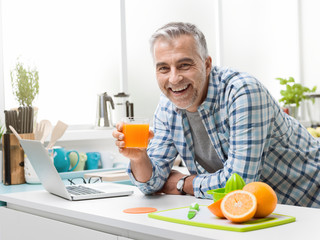 Man having a glass of fresh orange juice