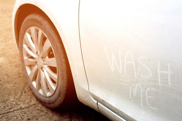Muddy car and dusty. Concept photo of car wash