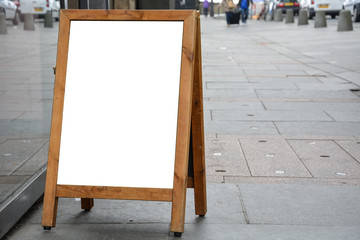 Blank ad space on wooden stand in the street