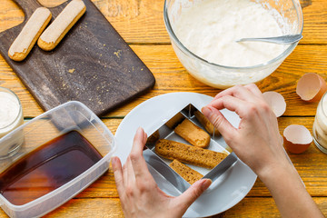 Image of preparation of tiramisu from biscuits