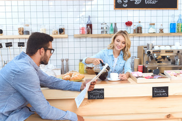 waitress pouring coffee to client