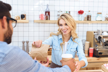 waitress and client with coffee to go
