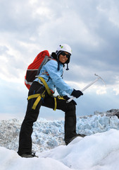The girl on the icy top of Falljokull Glacier