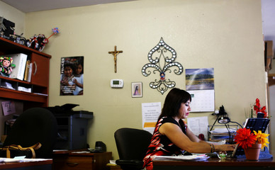 Coty Alcala, who was connected with health insurance by Maria Losoya, works at her tax preparation office in Nogales