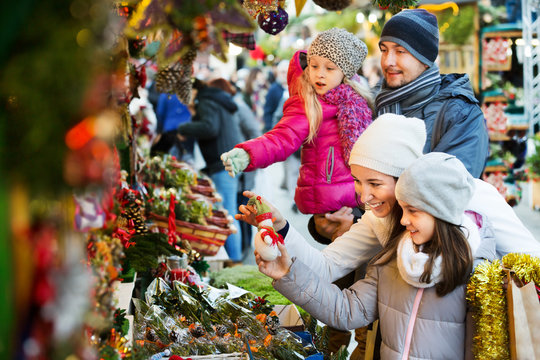 Family standing at coniferous souvenirs counter