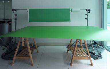 Green screen paper backdrop and tripod.