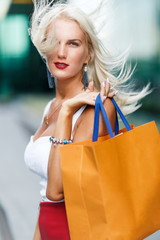 Girl with shopping in bags
