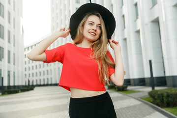Picture of blonde in red sweatshirt and black hat