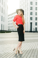 Photo of girl in red jacket and black hat