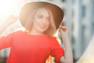 Picture of model in red jacket and black hat