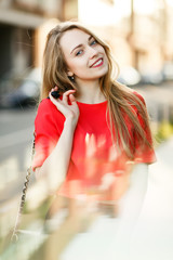 Photo of smiling woman in red jacket