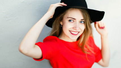 Image of smiling beautiful blonde in black hat