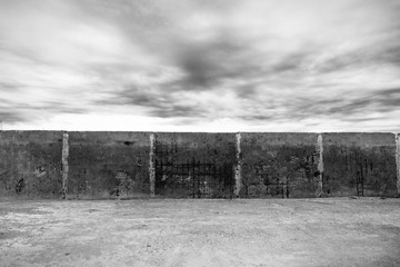 Black and white old  wall with clouds.