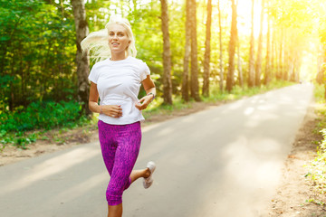 Image of sports girl running on road