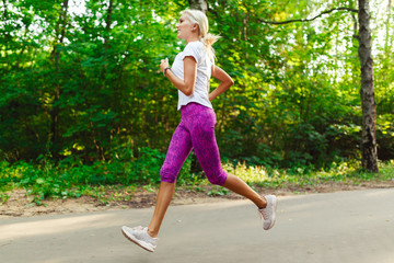Image of sports girl jogging on road