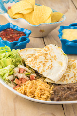 Spinach mushroom quesadillas with refried beans and rice.