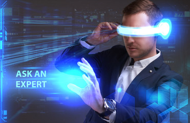 Business, Technology, Internet and network concept. Young businessman working in virtual reality glasses sees the inscription: Ask an expert