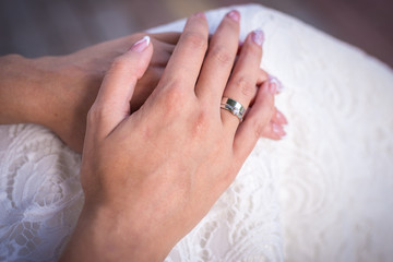 the bride's hand with the ring