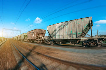 The railway hopper car for the transportation rail road train in motion at speed.