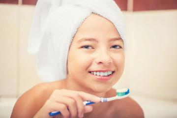 Teenage girl in the  bathroom with toothbrush. Dental hygiene