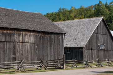old wooden barns in pioneer village