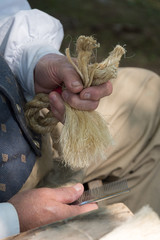man's hands doing rope craft