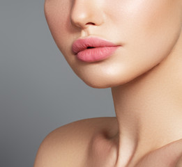 Sexy plump full lips. Close-up face detail. Perfect natural lip makeup. Close up photo with beautiful female face
