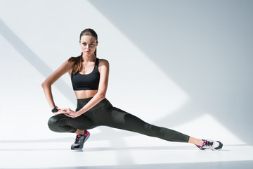 sporty woman stretching legs Wall mural