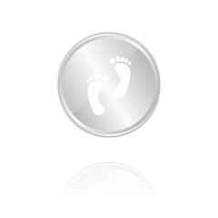 Fußspuren - Silber Münze mit Reflektion