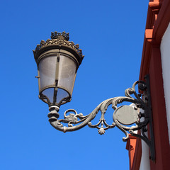 old vintage street light in tenerife spain with decorative traditional style and glass shade