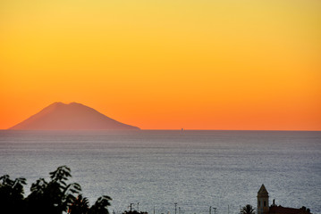 sunset of the volcano Stromboli seen from Tropea
