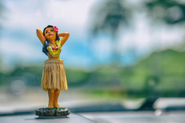 Hula dancer doll on Hawaii car road trip travel vacation. Aloha mini girl doll dancing on the...