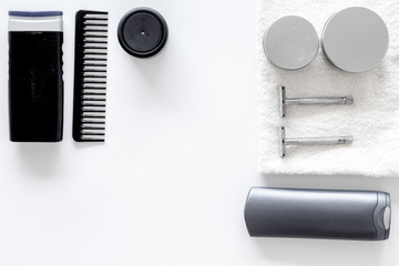 Men's shaving. Tools and cosmetics on white background top view copyspace