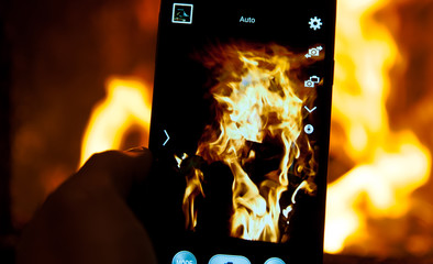 Photographing the fire with mobile phone.