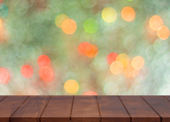 Empty wooden floor. blurred colorful bokeh light background